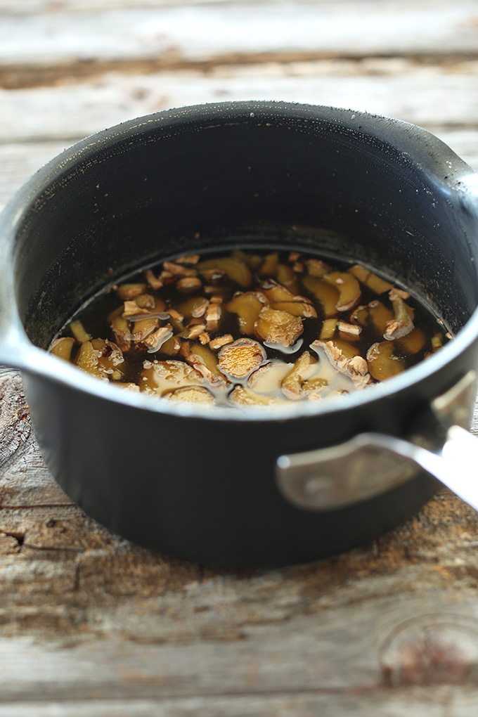 Making homemade ginger syrup in a saucepan