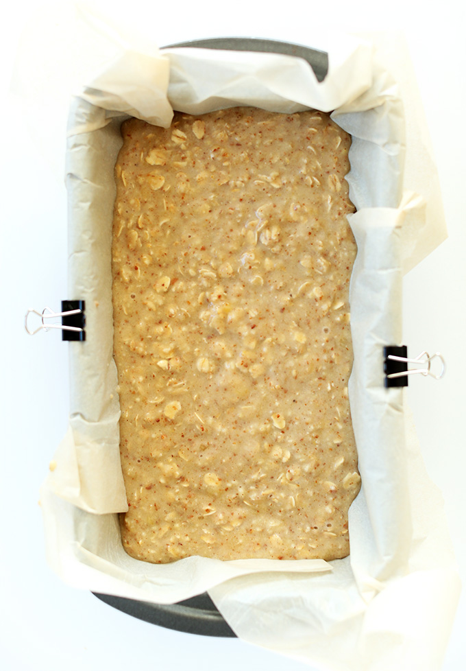 Gluten free banana bread batter in a loaf pan ready to go in the oven