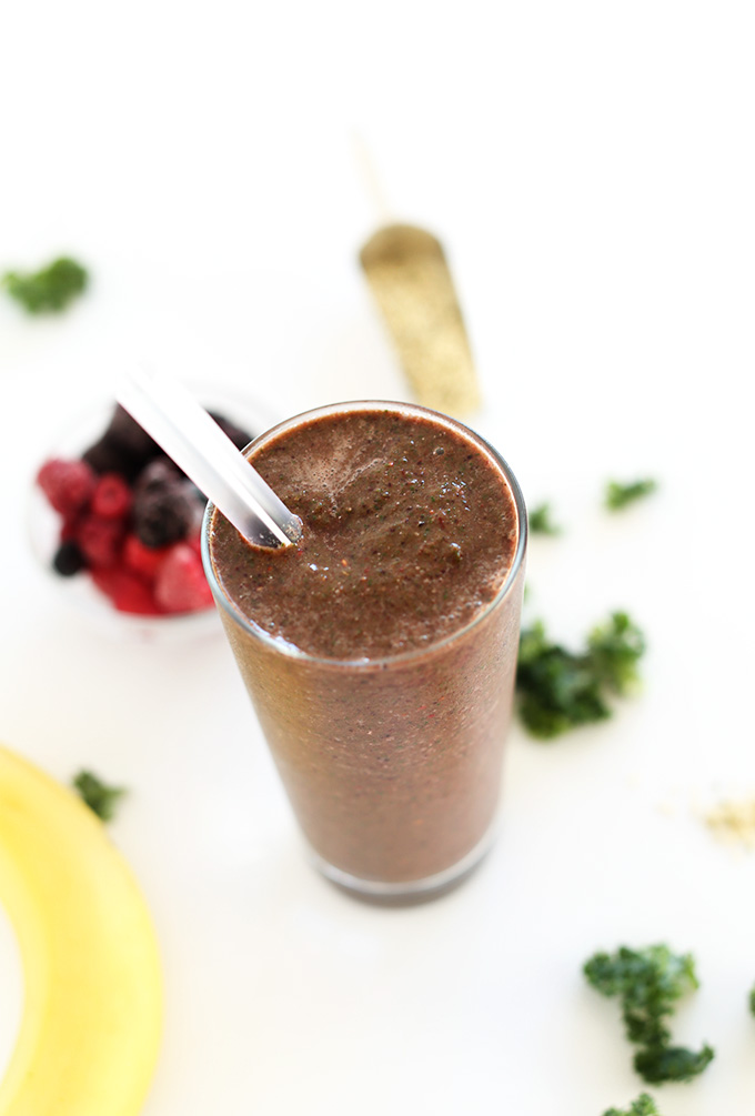 Glass of Hide Your Kale Smoothie made with kale, berries, and banana