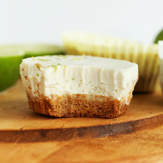 Half eaten Mini Vegan Key Lime Pie on a cutting board