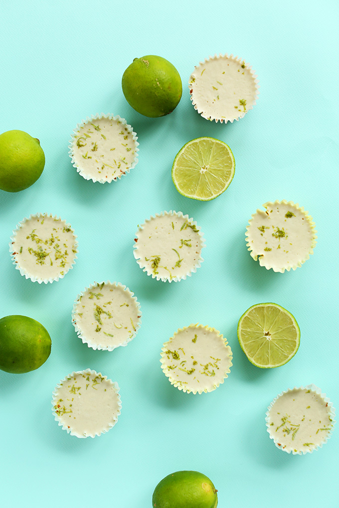 Mini Vegan Key Lime Pies surrounded by lime halves