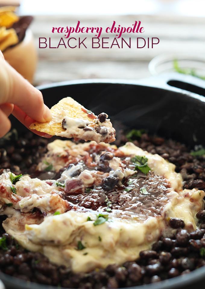 Grabbing a scoop of Vegan Raspberry Chipotle Black Bean Dip for game day
