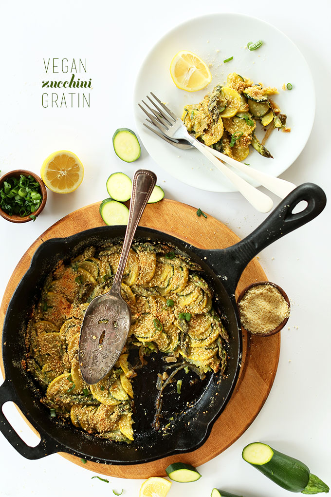 Skillet of Vegan Zucchini Gratin with a wedge removed