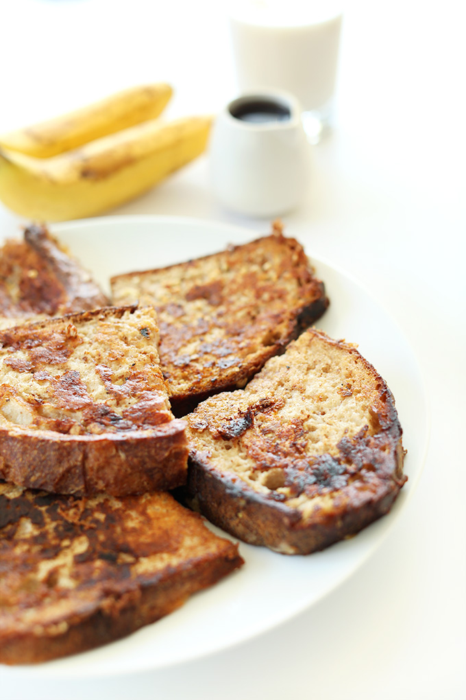 Slices of Vegan Banana French Toast with banana, almond milk, and maple syrup