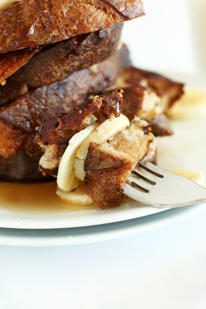 Fork with a big bite of Vegan Banana French Toast