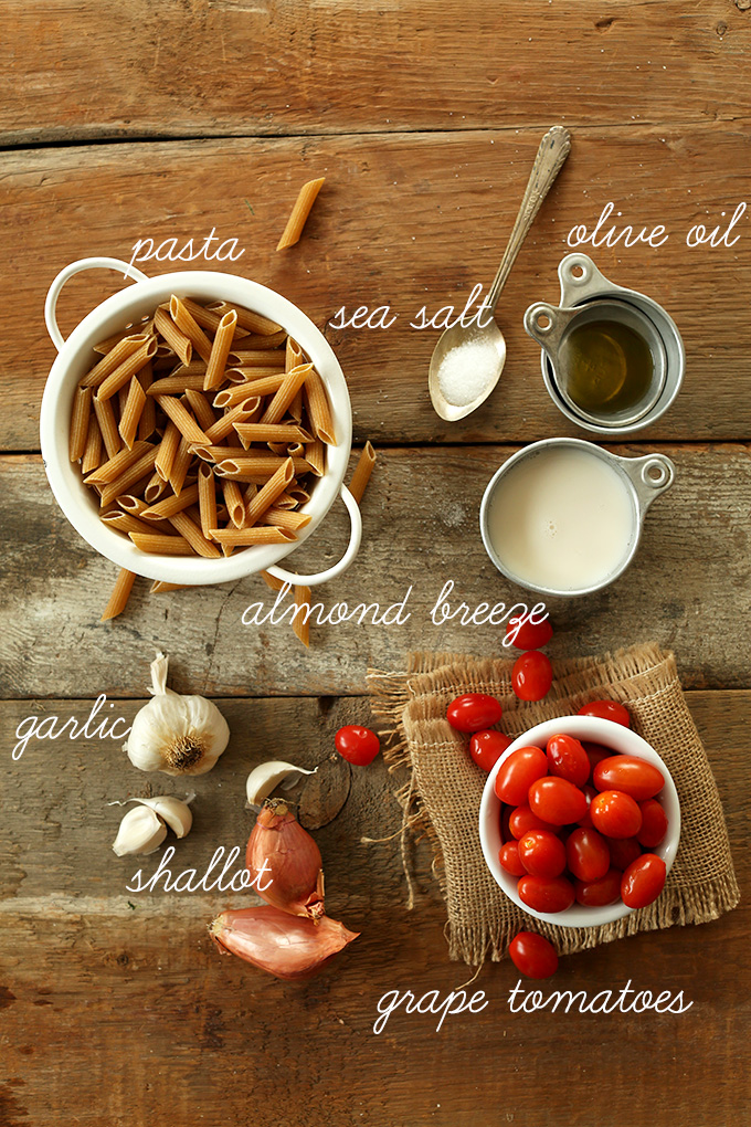 pasta, garlic, shallots, tomatoes and other ingredients for Dairy-Free Creamy Garlic Pasta