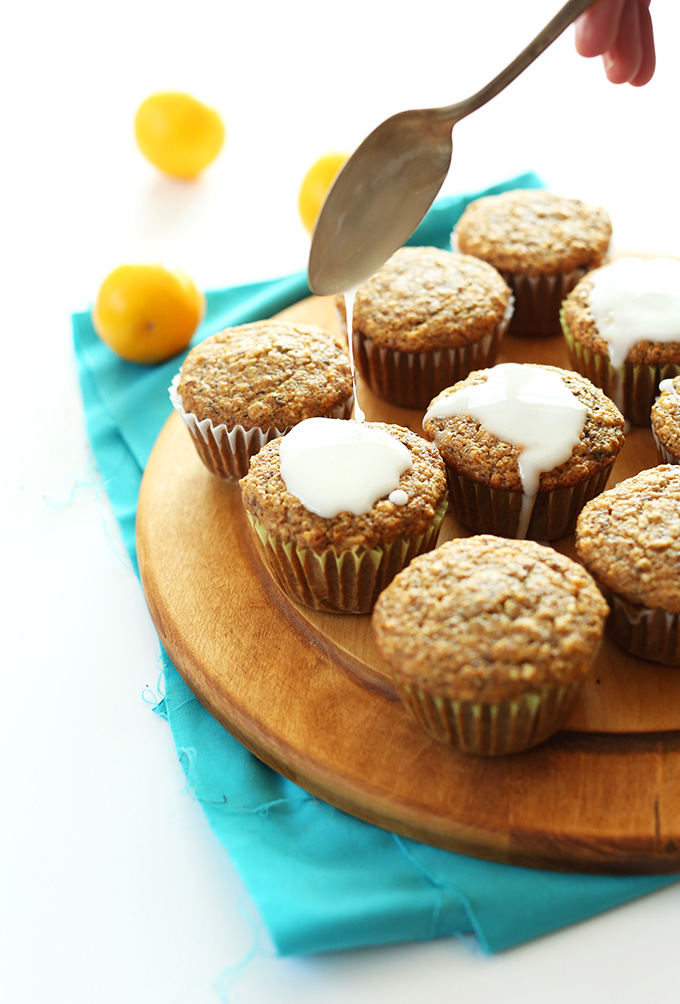 Drizzling icing onto a batch of our Easy 1-Bowl Meyer Lemon Poppyseed Muffins