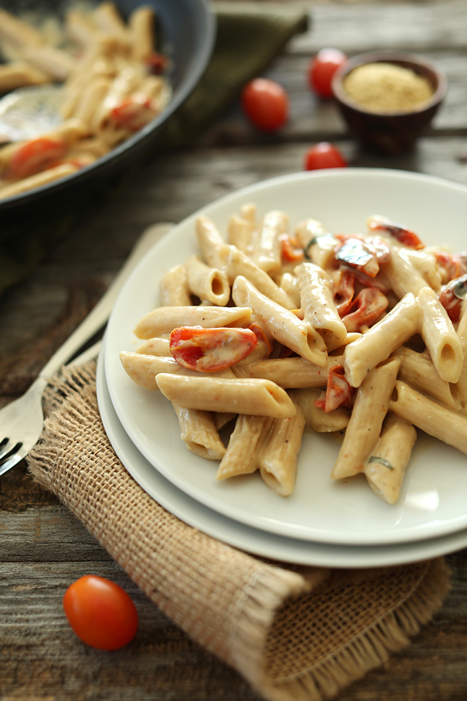 Plate of Creamy Vegan Garlic Pasta with Roasted Tomatoes
