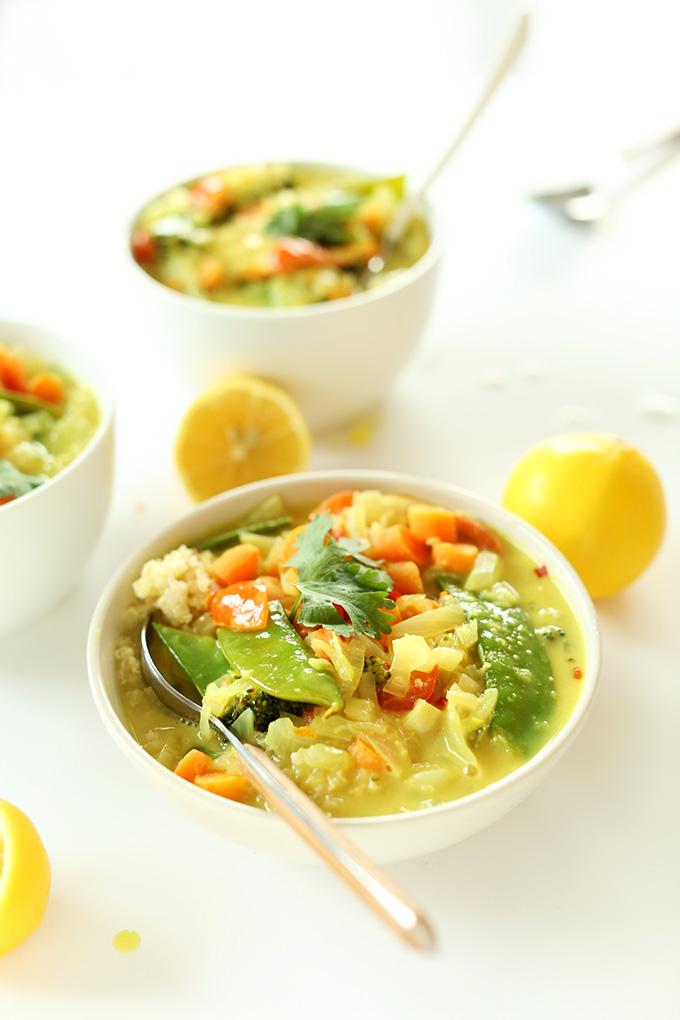 Lemon halves and bowls of Easy Coconut Curry with Coconut Quinoa