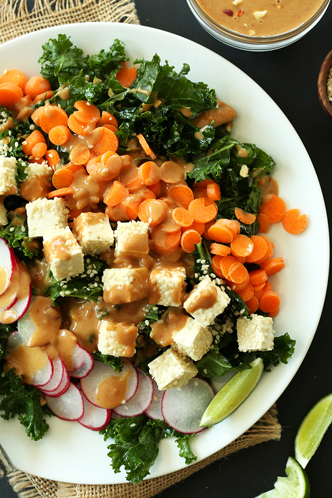 Big plate of Easy Vegan Gluten-Free Thai Kale Salad with Simple Peanut Dressing