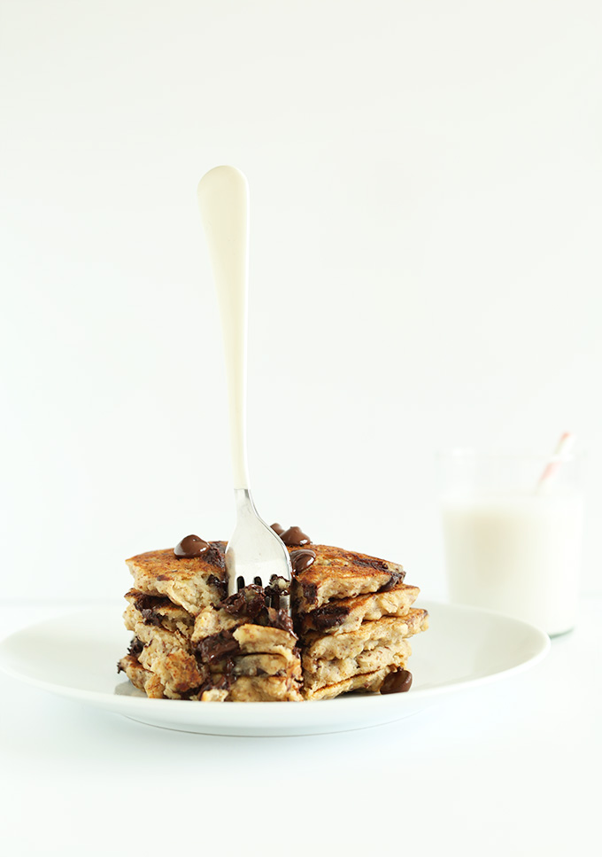 Fork standing up in a stack of Oatmeal Chocolate Chip Cookie Pancakes