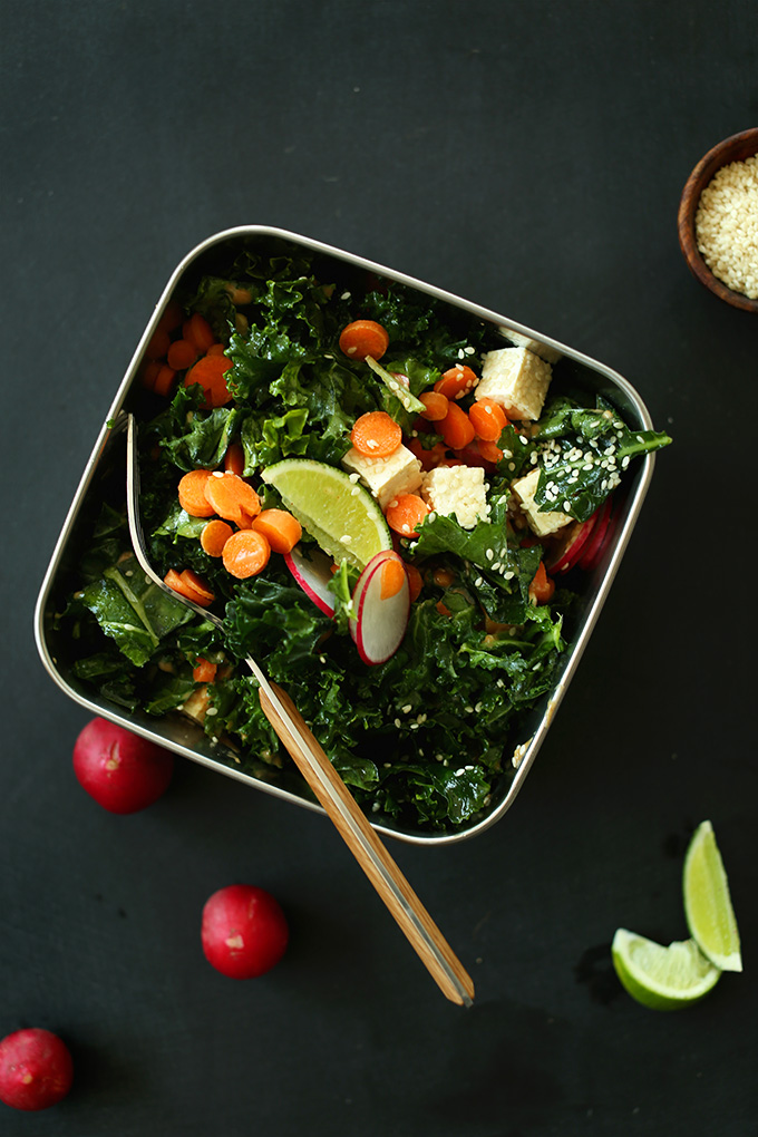 Stainless steel lunchbox filled with Massaged Thai Kale Salad
