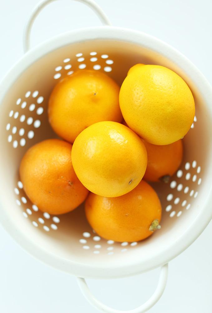 Colander of fresh meyer lemons for making delicious poppyseed muffins