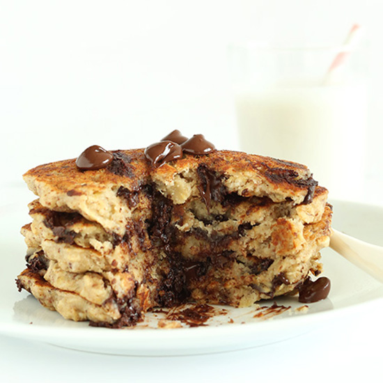 Stack of Chocolate Chip Oatmeal Cookie Pancakes with a slice removed
