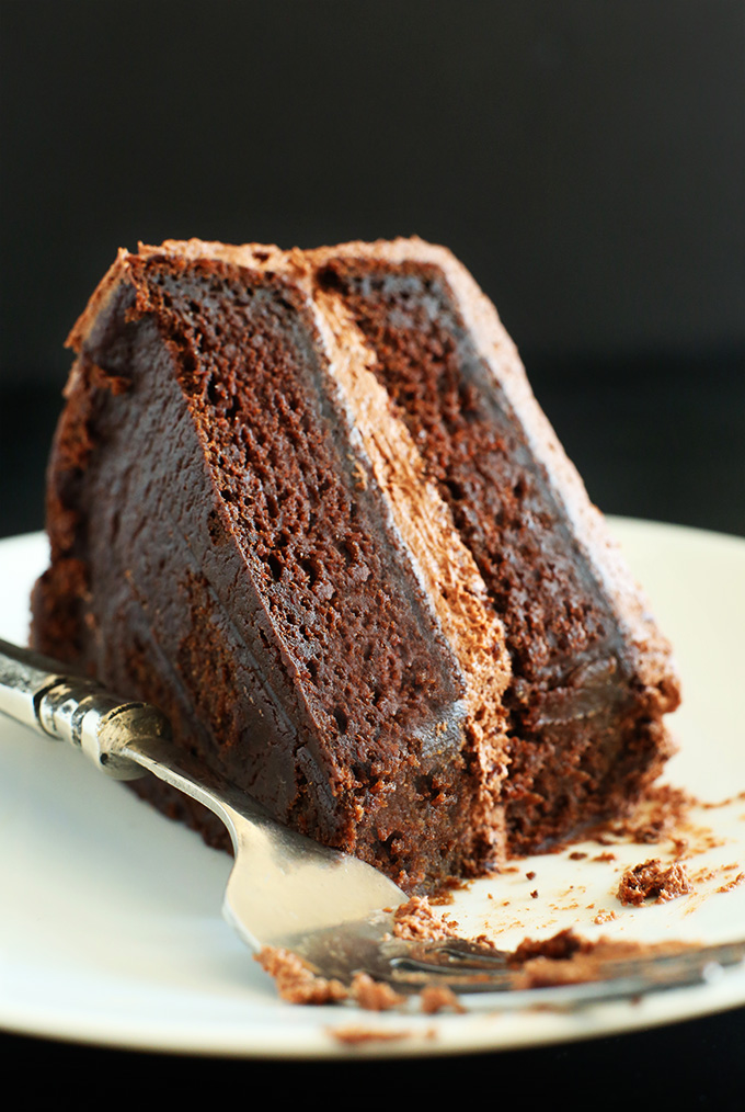 Slice of delicious and moist Vegan Chocolate Cake for dessert