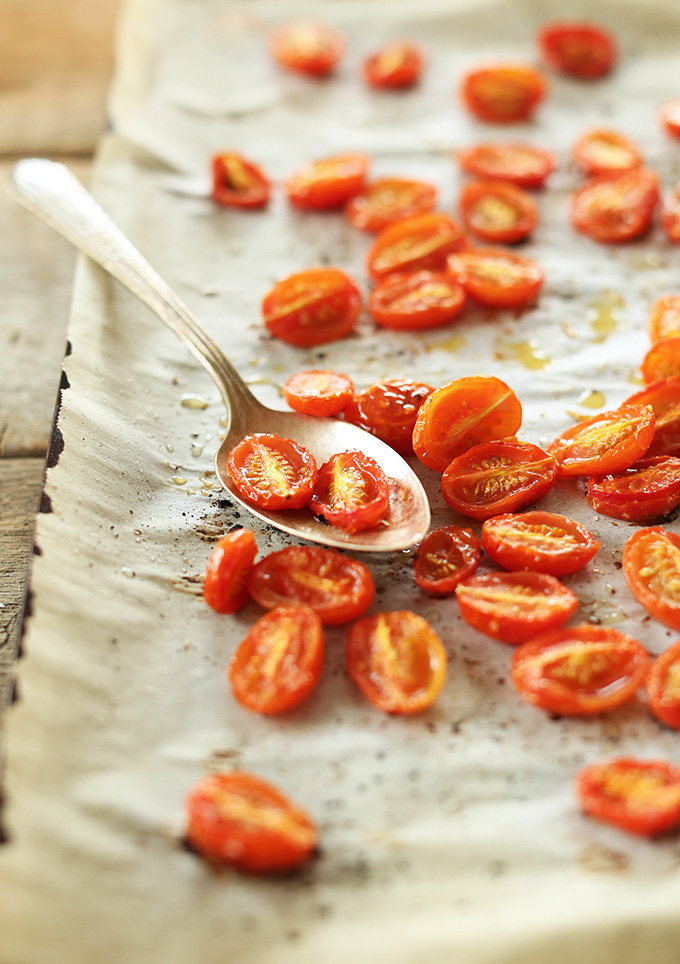 Parchment-lined baking sheet with freshly Roasted Tomatoes