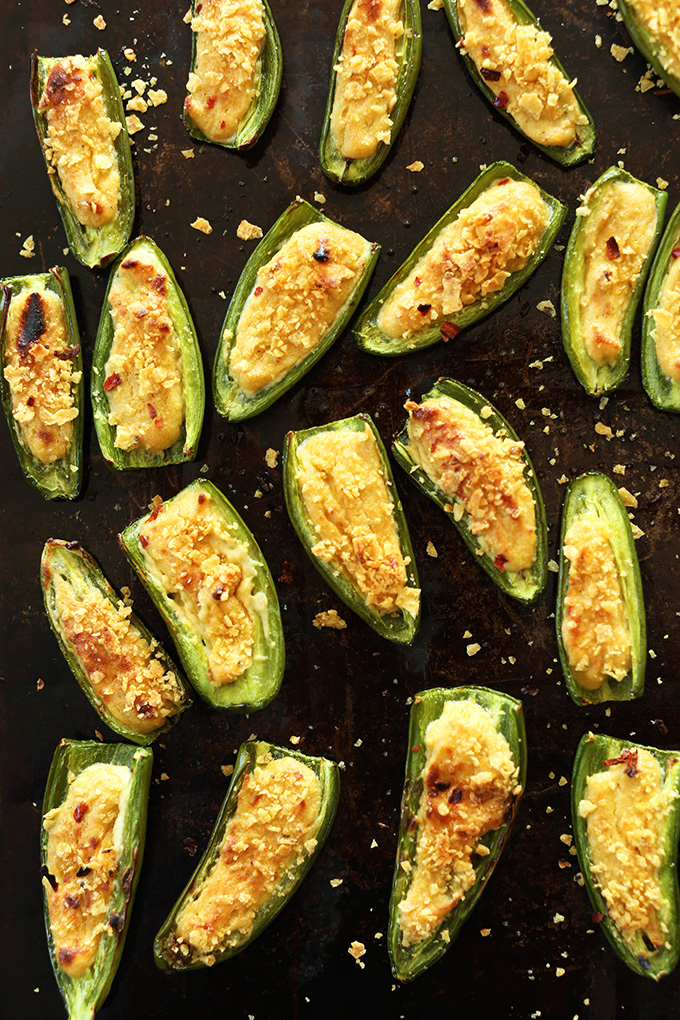 Jalapeno Poppers on a baking sheet for a delicious gluten-free vegan appetizer