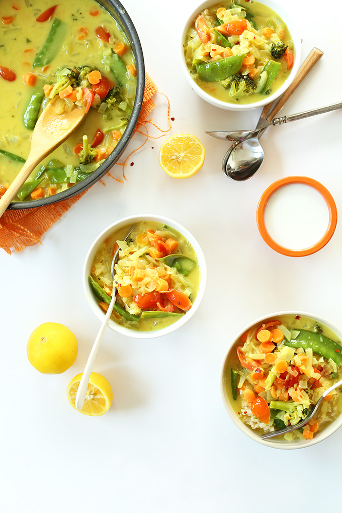 Pan and bowls of Simple Coconut Curry over Coconut Quinoa
