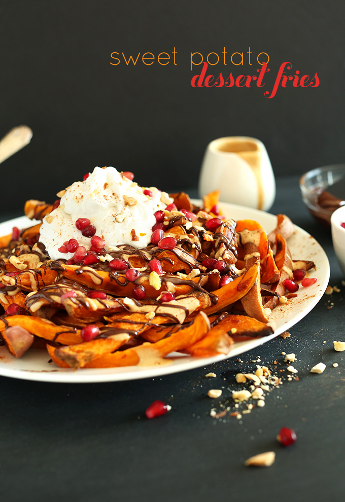 Plate of Sweet Potato Dessert Fries topped with pomegranate seeds, coconut whipped cream and more