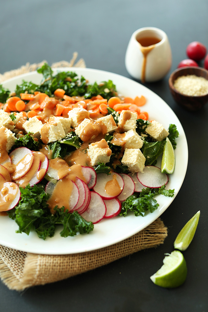 Plate of our Thai Kale Salad recipe with Sesame Tofu and Peanut Dressing