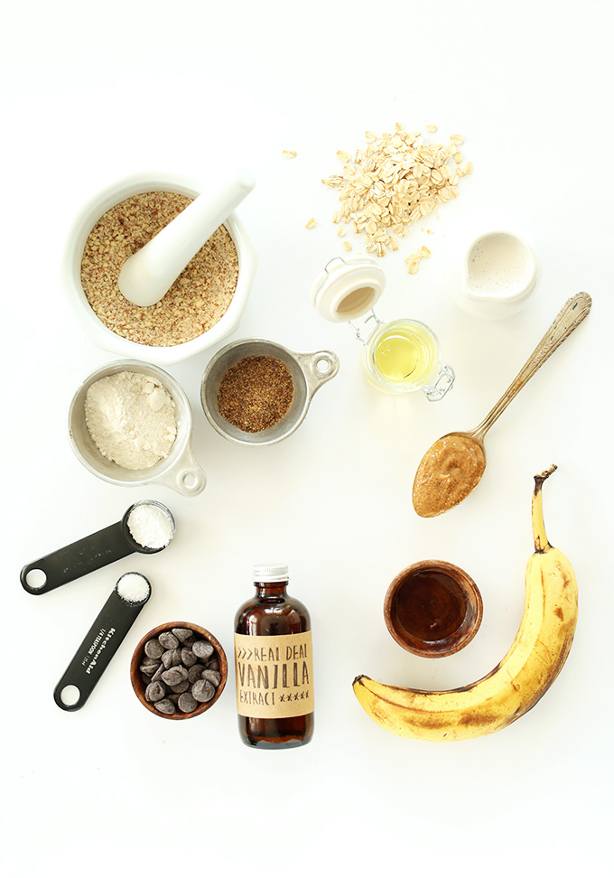 Banana, oats, peanut butter and other ingredients for making gluten-free vegan pancakes