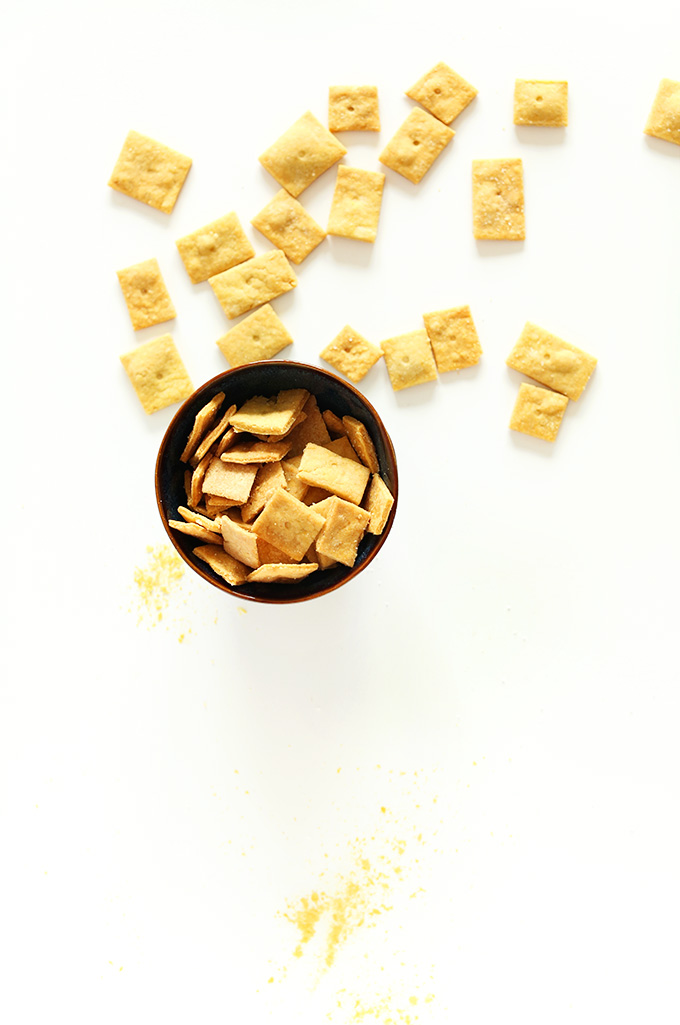 Bowl and scattering of homemade Vegan Cheez Its