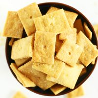 Top down shot of a bowl filled with homemade Vegan Cheez Its
