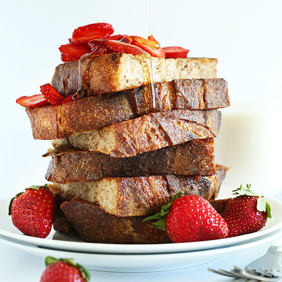 Plate piled high with slices of our Vegan French Toast Recipe