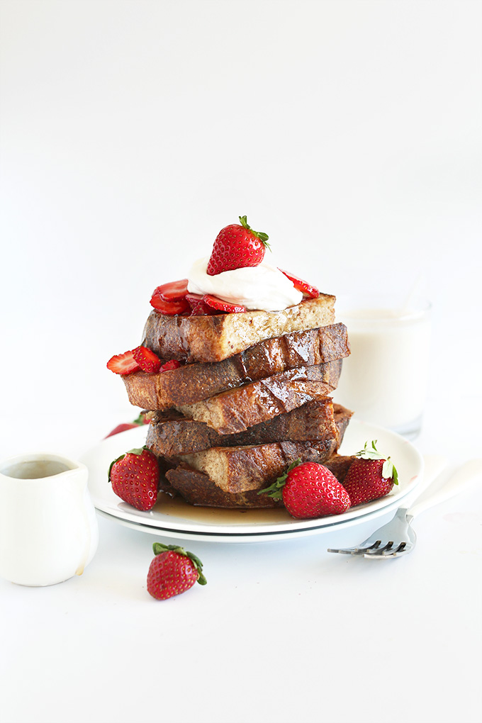 Tall stack of Vegan French Toast with Fresh Strawberries and Coconut Whipped Cream