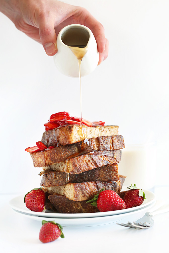 Pouring agave onto a stack of our Vegan French Toast recipe