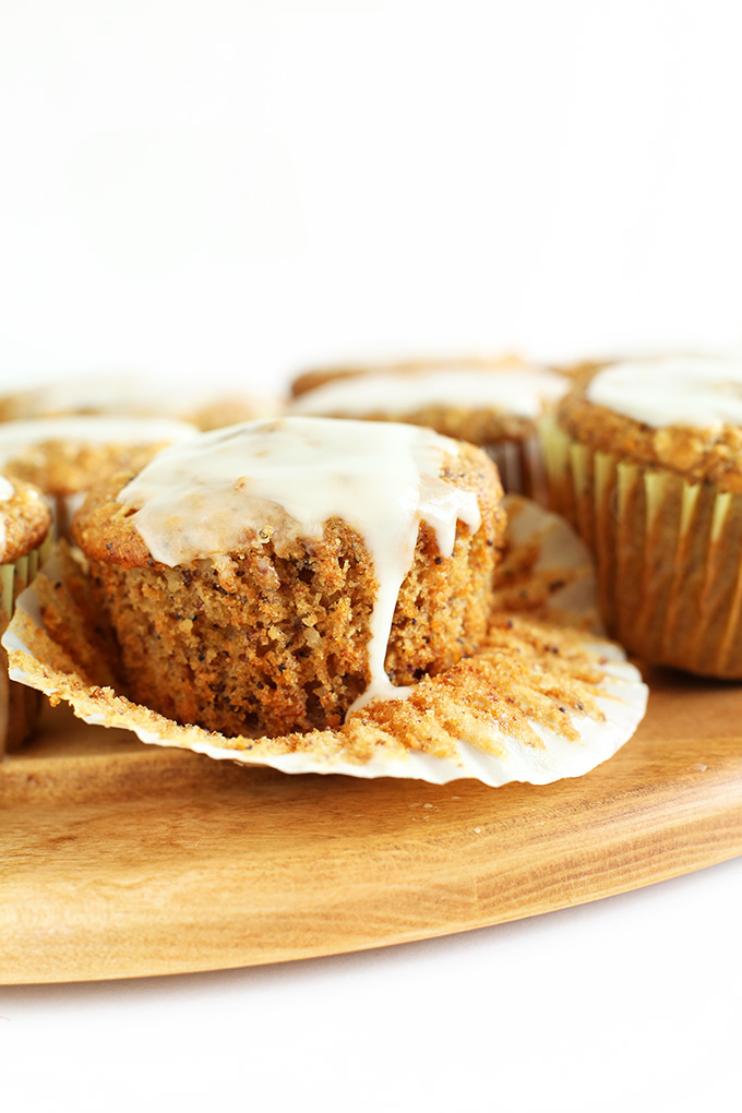 Parchment paper liner pulled down to reveal the texture of our Vegan Meyer Lemon Muffins