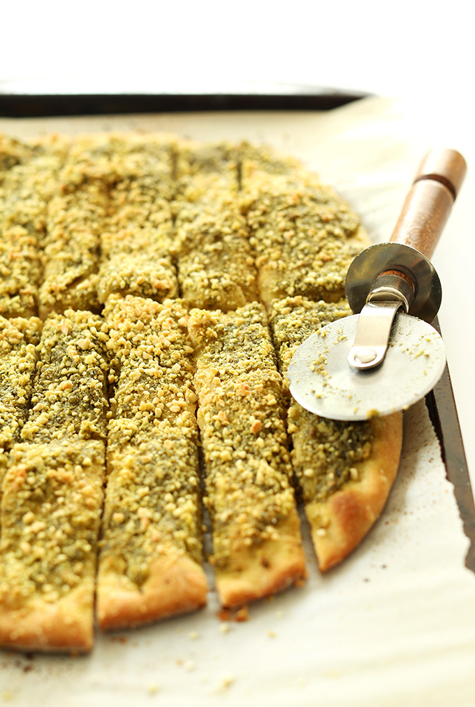 Vegan Pesto Breadsticks sliced with a pizza cutter
