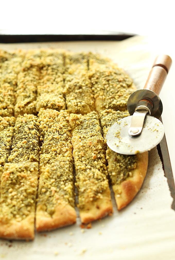 Vegan Pesto Breadsticks sliced with a pizza cutter