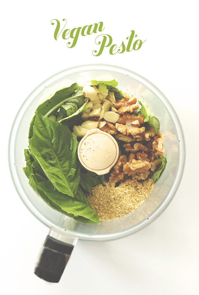 Food processor with ingredients for Vegan Pesto