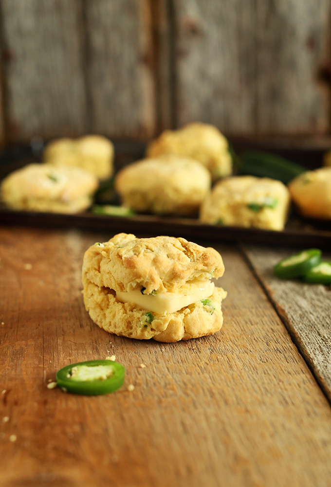 Close up shot of a Cheddar Jalapeno Biscuit stuffed with a square of vegan butter in it