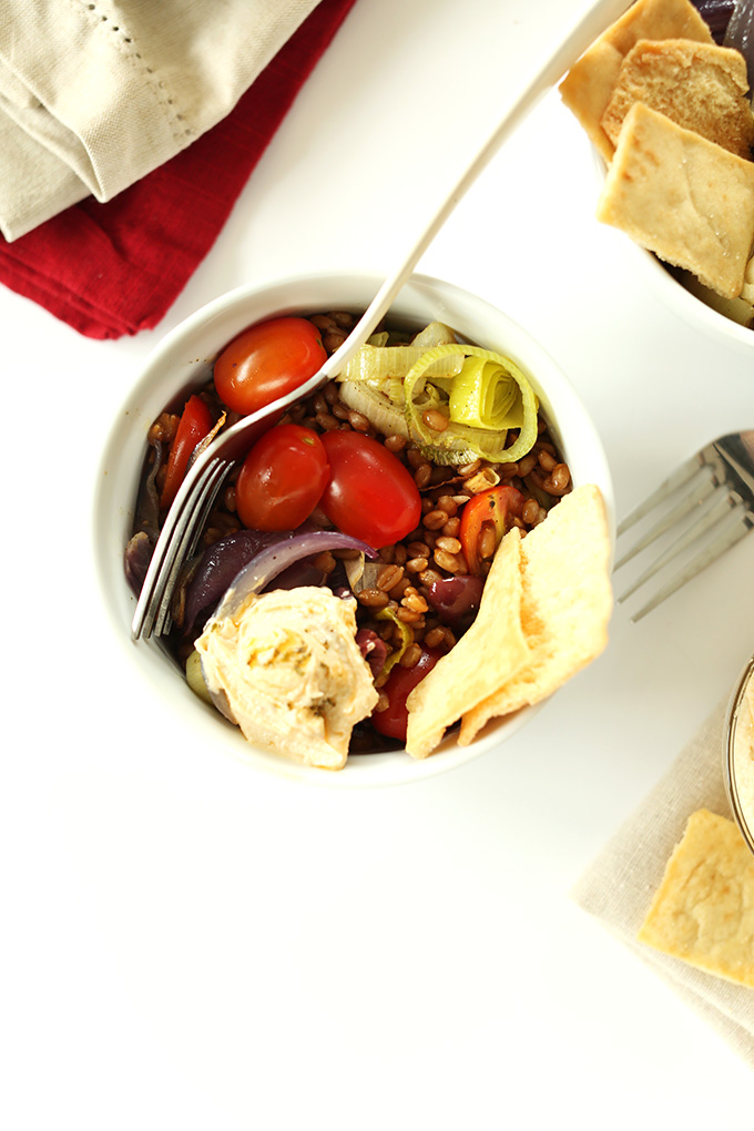 Top down shot of a Mediterranean Wheat Berry Salad Bowl made with roasted veggies