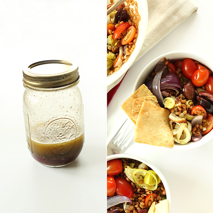 Glass jar of salad dressing to go on bowls of Mediterranean Wheat Berry Salad