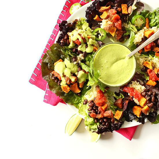 Bowl of dressing surrounded by Mexican Quinoa Salad Cups