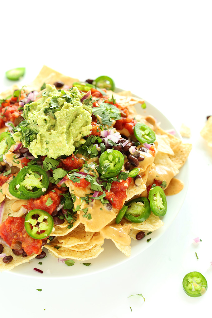 Plate piled high with the Best Damn Vegan Nachos