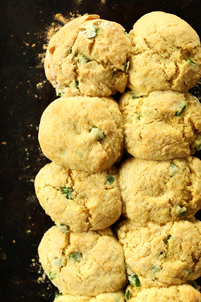 Batch of freshly baked Vegan Cheddar Jalapeno Biscuits on a baking sheet