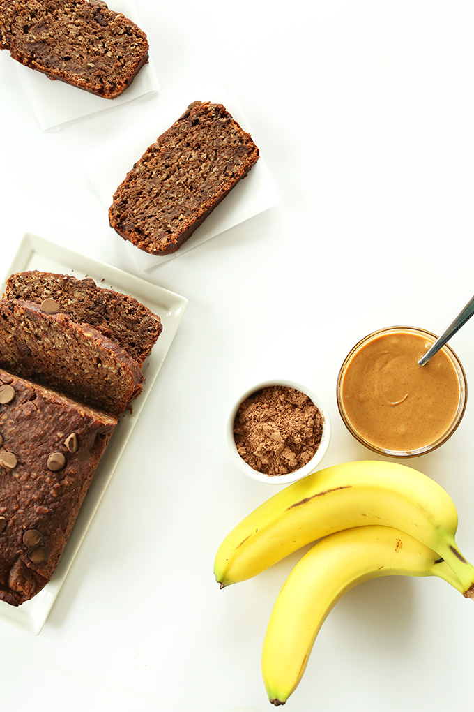 Slices and loaf of Vegan Chocolate Banana Peanut Butter Snack Bread