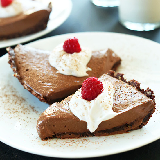'Vegan Chocolate Silk Pie! 6 Ingredients, No Baking required and SO silky, chocolaty, and delicious #minimalistbaker' from the web at 'https://minimalistbaker.com/wp-content/uploads/2014/04/Vegan-Chocolate-Silk-Pie-6-Ingredients-Blender-friendly-and-SO-delicious.-Freezes-perfectly-square.jpg'