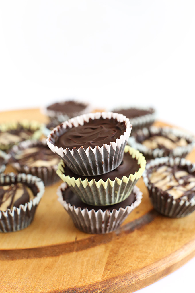 Stack of Vegan Peanut Butter Mousse Cups with a crunchy chocolate shell