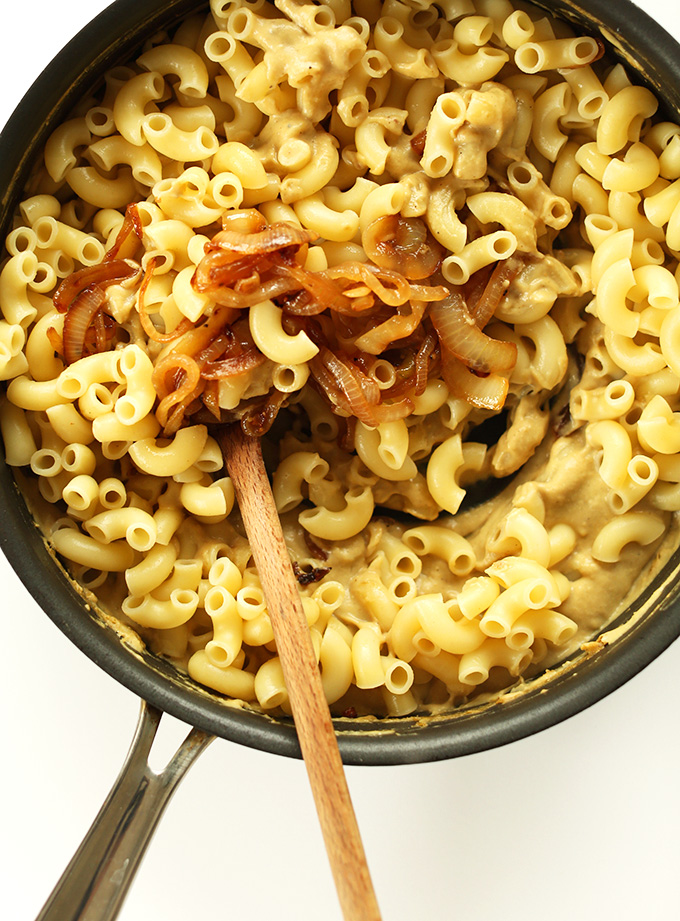 Caramelized onion and pasta in a pan for making vegan Caramelized Onion Mac n Cheese