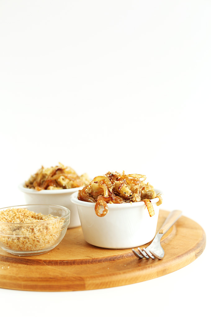 Bowls of Vegan Caramelized Onion Mac n Cheese with breadcrumbs