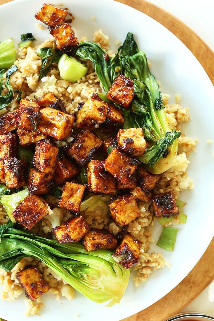 Plate of Peanut Glazed Crispy Baked Tofu over cauliflower rice and bok choy