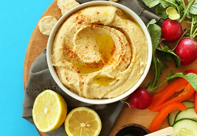 Bowl of creamy homemade hummus with veggies for dipping