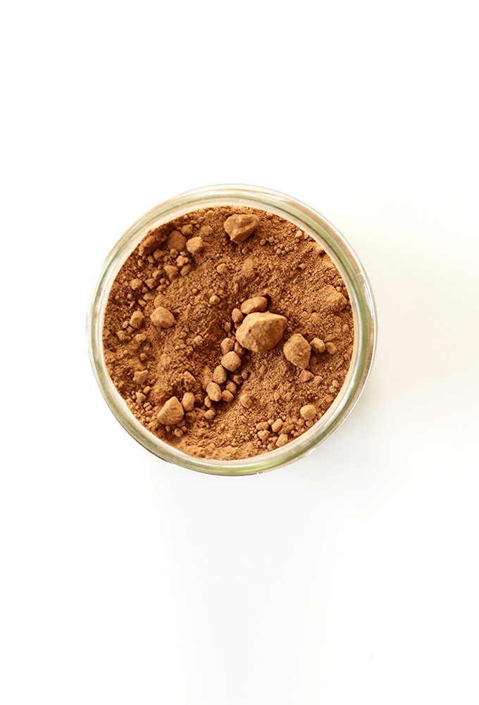 Jar of cacao powder for making homemade chocolate granola bars