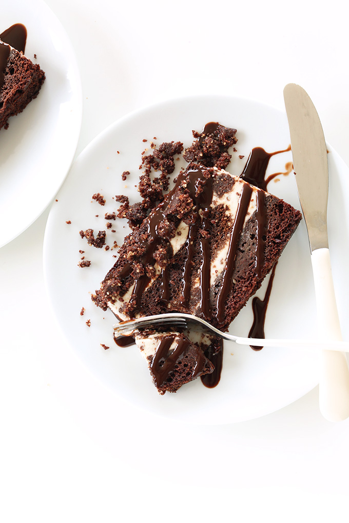 Grabbing a bite of a slice of Fudgy, Creamy Vegan Chocolate Mint Ice Cream Cake