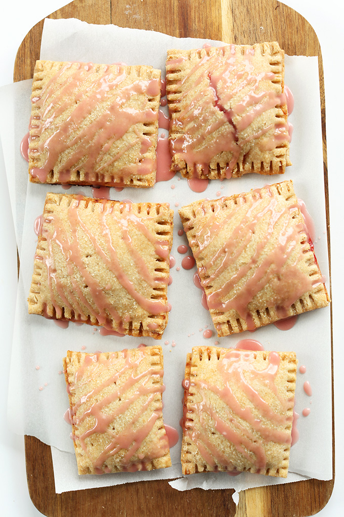 Homemade Vegan Strawberry Rhubarb Pop Tarts on a parchment-lined cutting board